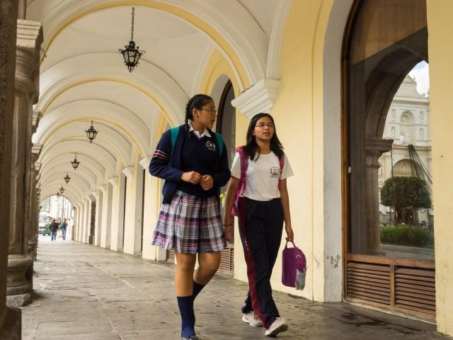 School Girls Walking in Antigua Guatemala BY RUDY GIRON