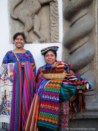 Maya Women Selling Textiles in the Streets of Antigua Guatemala by RUDY GIRON