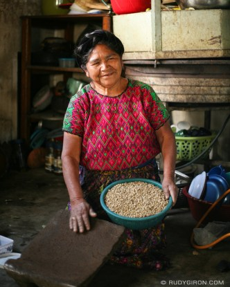 Portrait of a Maya grandmother ready to grind some coffee.