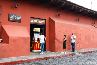 Pandemic Vista - People queueing to buy fast-food in Antigua Guatemala BY RUDY GIRON