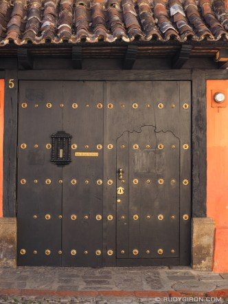 STOCK PHOTO: Colonial style wooden door with brass studs