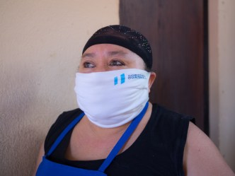 PHOTO STOCK: Bakery clerk wears a Guatemalan government provided face mask