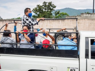 PHOTO STOCK: Truck being used as public transportation in lieu of the traditional color buses.