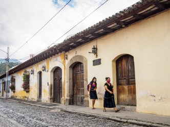 PHOTO STOCK: Two face-masked Maya women walk through deserted streets in Antigua Guatemala