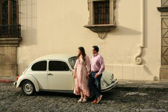 Newly-engaged Couple in front of a white VW