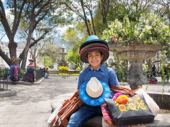 PHOTO STOCK: Mayan Ambulant Vendor Selling Hats in Antigua Guatemala