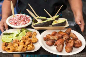 PHOTO STOCK: Guatemalan Chicharrones and Carnitas with Avocado and Chojin