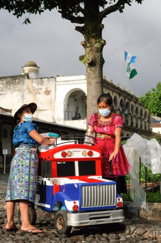 Sights of Antigua — Colorful Bus Ice Cream Cart by RUDY GIRON