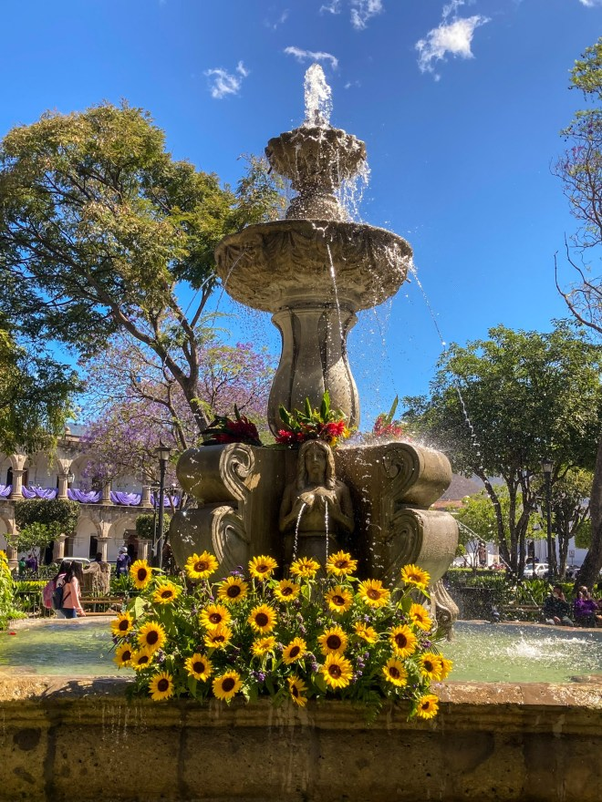 PHOTO STOCK: Mermaids Fountain Adorned with Sunflowers by RUDY GIRON
