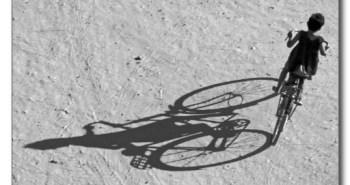 myamar_bagan_young_boy_riding_a_huge_bike_and_postcard-r562147db1a7442aa97c66960b8cbb1cb_vgbaq_8byvr_512