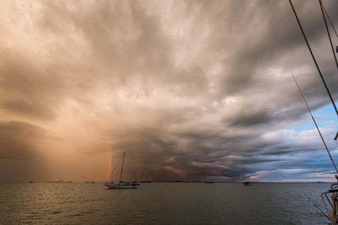 In-a-surreal-moment-the-bottom-of-the-storm-cell-glows-red-from-the-sunset-while-a-rainbow-appears-momentarily