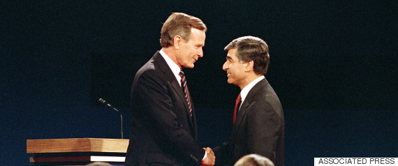 Democratic candidate and Massachusetts Gov. Michael Dukakis shakes hands with Vice President and Republican candidate George Bush, left, prior to their second and final debate at Pauley Pavillion on UCLA campus, in Los Angeles, Calif., on October 13, 1988. (AP Photo/Lennox McLendon)
