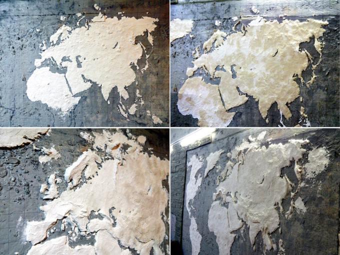 Житель из Надыма превратил пустую стену своего гаража в трехмерную карту планеты
