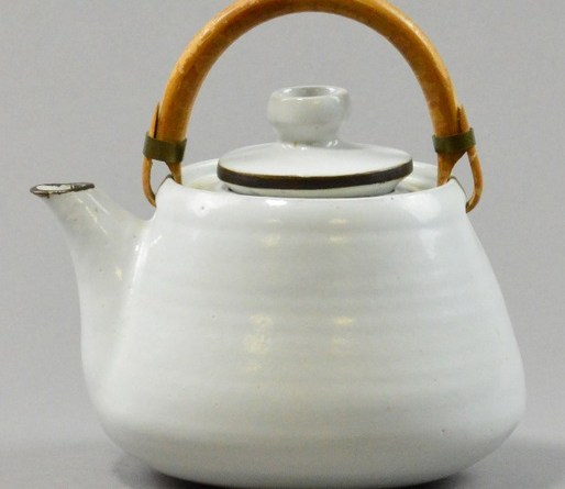 LUCIE RIE (1902-1995); a stoneware teapot, white glaze with manganese detail to spout and cover,