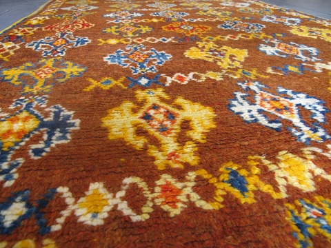 Buy and antique rug to give interiors some character