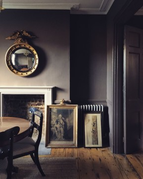 An interior with antique furniture and artworks