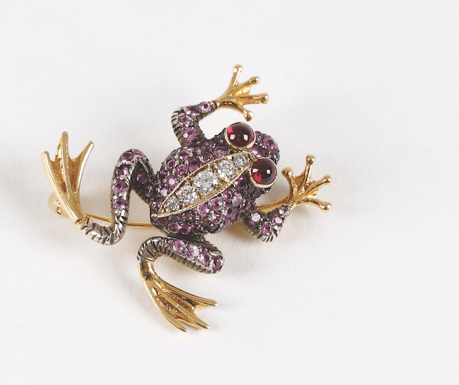 An antique leaping frog brooch