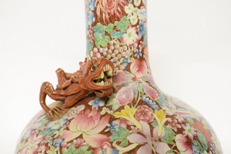A dragon on an antique Chinese millefleurs vase