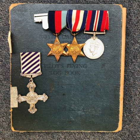The Distinguished Flying Cross, other medals and log book are included in the sale