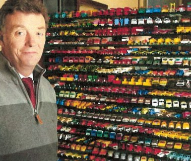 Simon Hope with his collection of Matchbox cars
