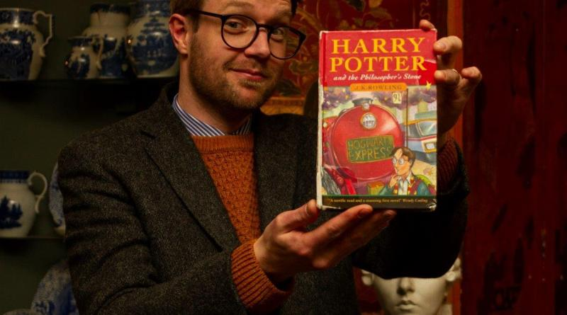 Harry Potter First edition with auctioneer