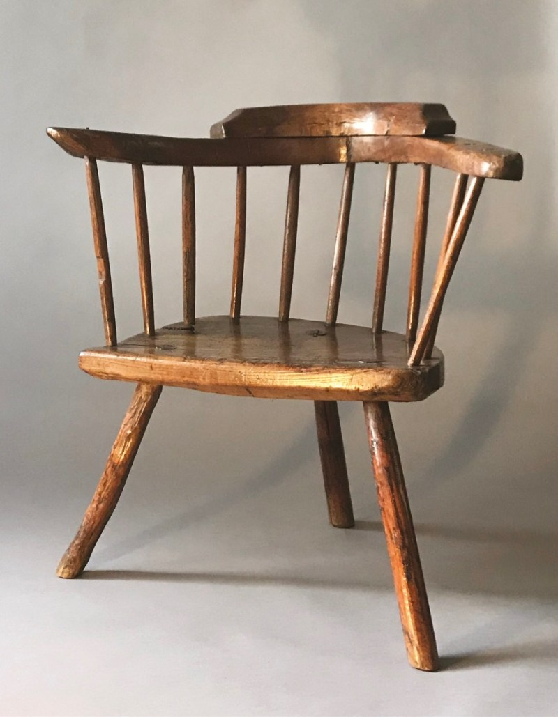 A small lowback 18th-century Cardiganshire stick chair with a wonderful, naturally-shaped one-piece arm with a low crest