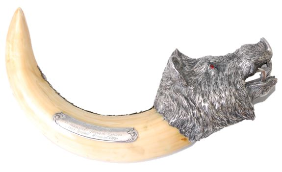 silver mounted wild boar's tusk cigar-cutter marked Fabergé