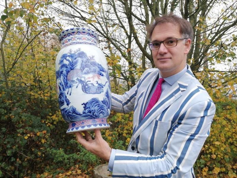 Charles Hanson with an antique Chinese vase