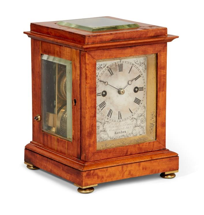 A Victorian satinwood cased library clock by Frodsham and Baker, circa 1860