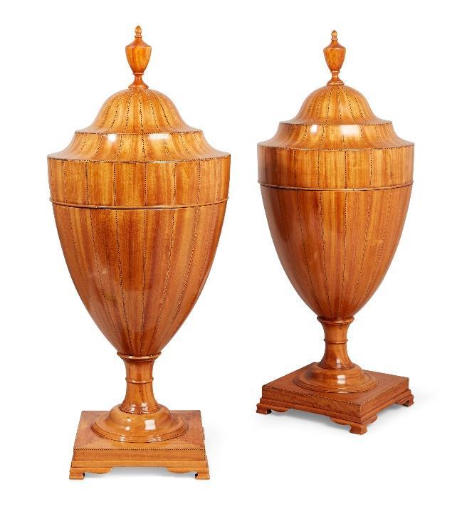 A pair of George III Sheraton satinwood cutlery urns