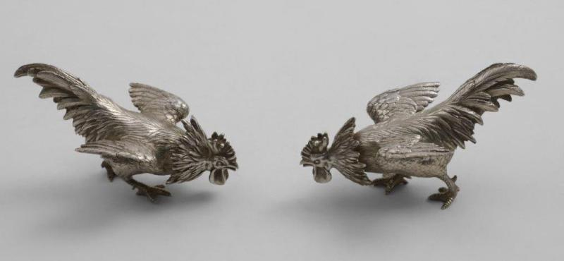 Pair of silver cocks fighting