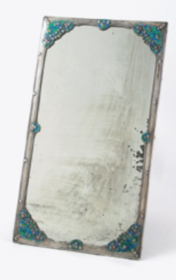 A rare Liberty and Co silver and enamel dressing table mirror, designed by Jessie M King, dated Birmingham 1907