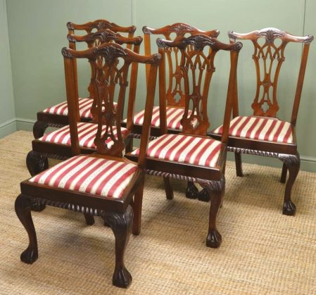 A pair of walnut Edwardian Chippendale design carver side chairs with pierced back splat, cabriole front legs and ball and claw feet
