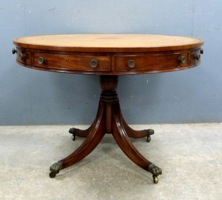 A 18th century mahogany drum table has been estimated at between £1,500 and £2,000