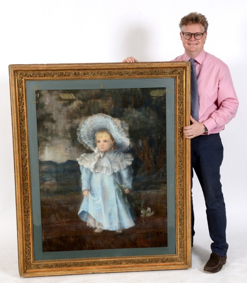 Martin Miller Antiques auctioneer Richard Bromell with pastel picture