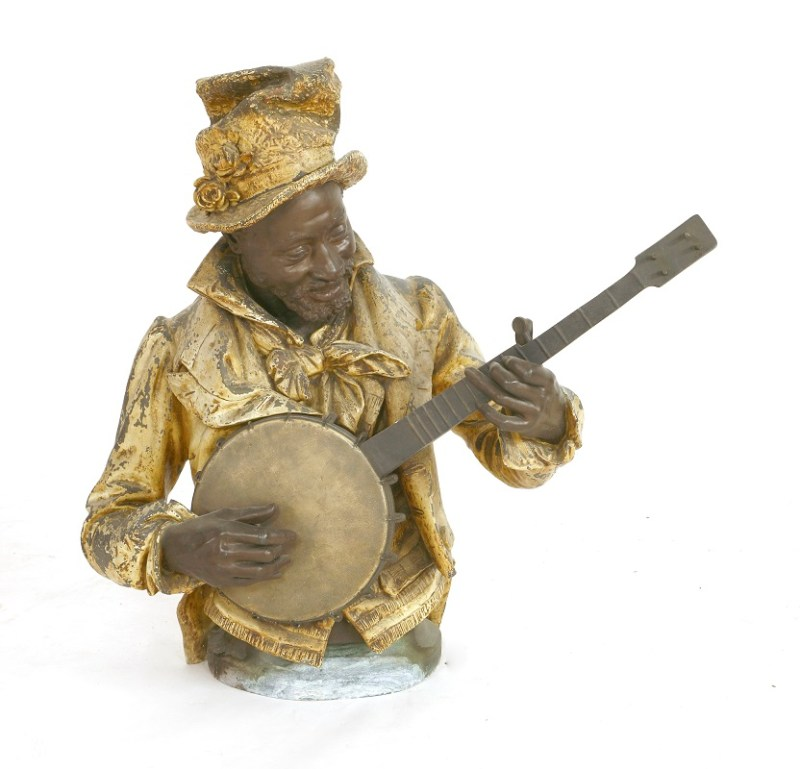 A cold painted spelter figure of a black musician