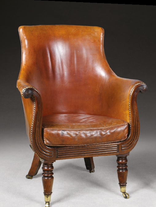 An antique leather library chair