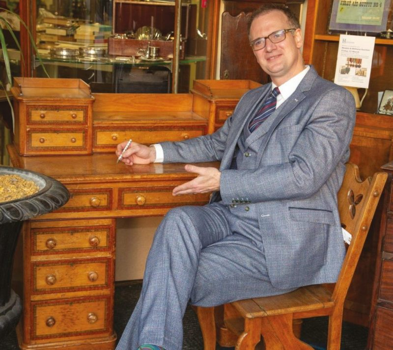 Charles Hanson sits at the Darwin family desk