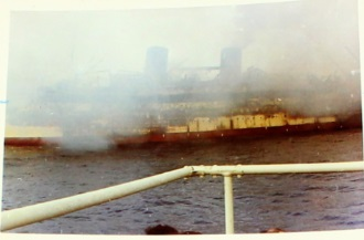 Lakonia on fire, picture by crew member of the Montcalm rescue ship