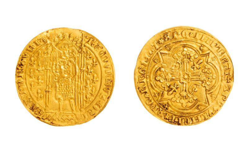 A gold coin found in hidden drawer in an antique bureau