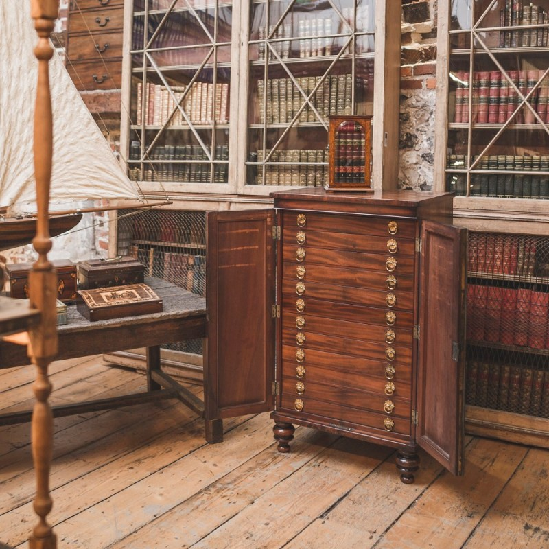 An antique collectors cabinet in Spencer Swaffer's shop