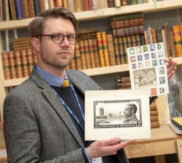 Hansons' Jim Spencer with some examples of stamp designs