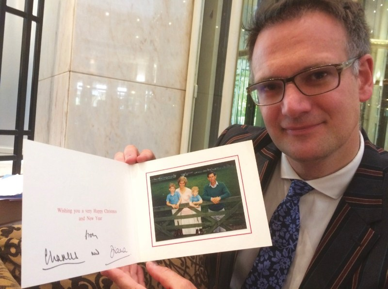 Auctioneer Charles Hanson with a photograph of Charles and Diana