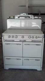 "1953 850 series most classic stove ever! 39"" W x 28"" D x 54"" H 2 16"" W Ovens 2 Broilers center Griddle S&P Shakers Clock Griddle Lamp ""Vanishing"" fold down shelf auxiliary plug beautiful design"