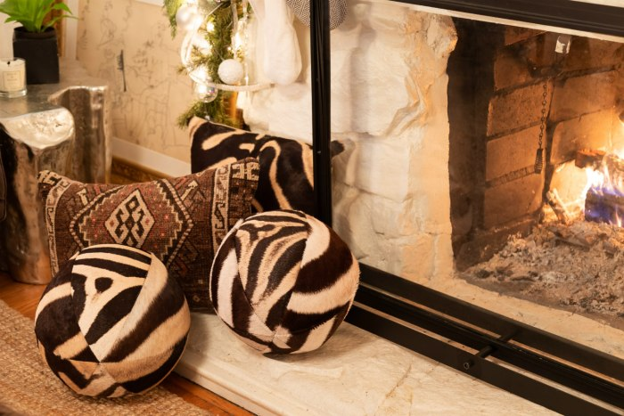 Zebra balls, zebra pillow, and antique Kurdish rug fragment pillow all from Paige Albright Orientals