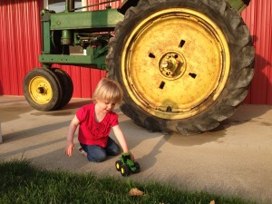 Ella-playing-with-tractor
