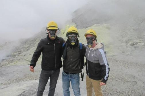 I can't figure out why no one can see them smiling, but Fernando Panduro (@PanduroFernando) and friends have safety masks on while exploring the sulphurous White Island in New Zealand: pic.twitter.com/ogFT71f4TW