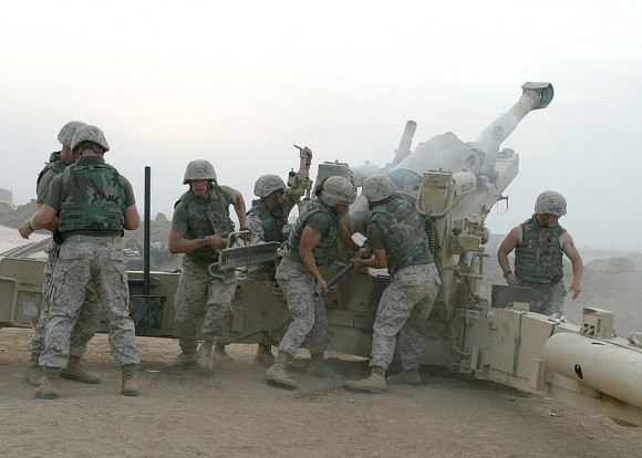 U.S. Marines fire a Howitzer in Fallujah, Iraq 2004.