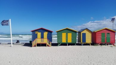 Muizenberg Beach with its colourful Victorian bathing boxes.