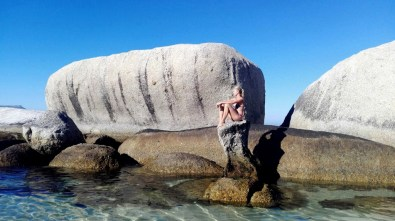 Boulders Beach is a sheltered beach with granite boulders, from which the name originated. It is located in the Cape Peninsula, near Simon's Town in the Western Cape province of South Africa.